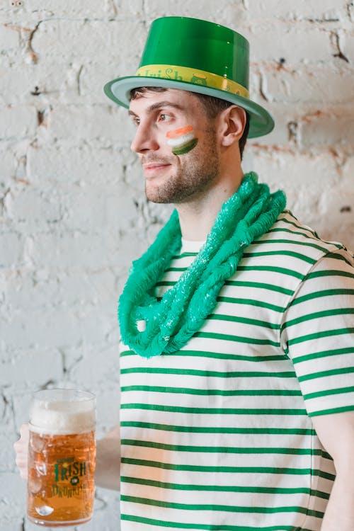 Contemplative man with beer celebrating Saint Patricks Day