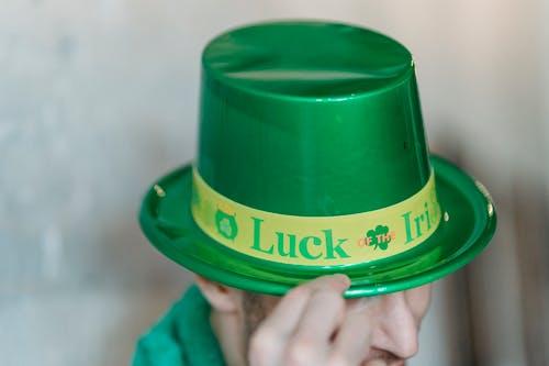 Crop man in green hat celebrating Feast of Saint Patrick