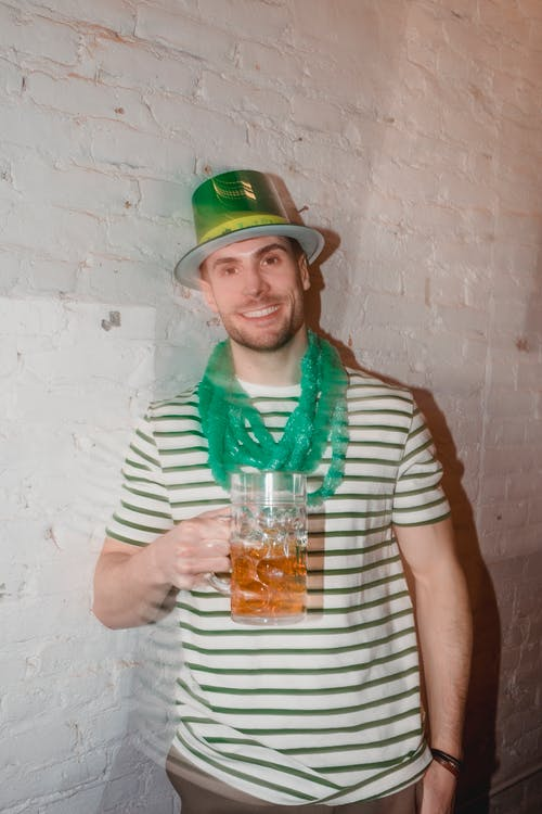Cheerful man with beer during Feast of Saint Patrick