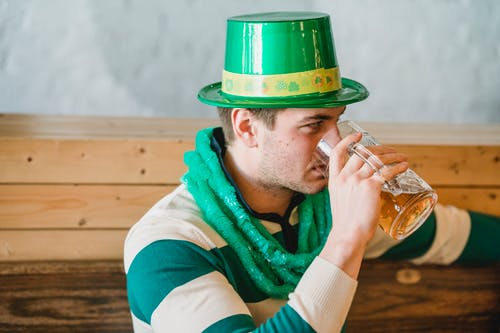 Man drinking beer during Feast of Saint Patrick