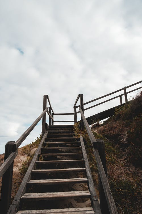 Wooden staircase on stony cliff slope
