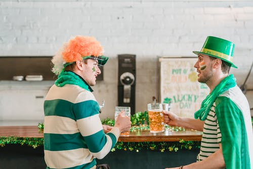 Friends with beer talking during Feast of Saint Patrick