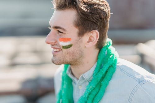 Handsome man with painted flag on face