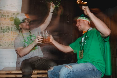 Happy friends celebrating national holiday drinking beer