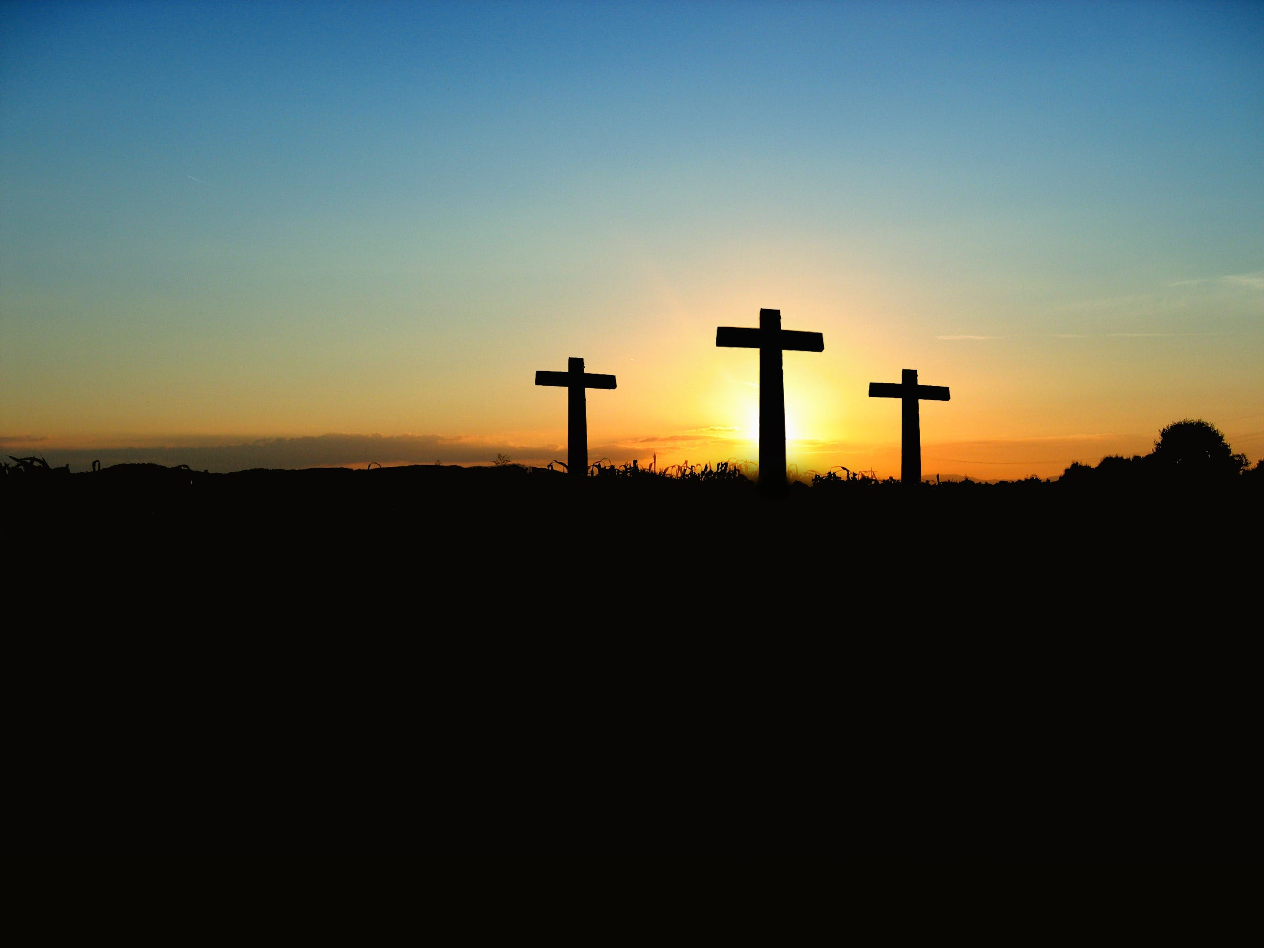 Silhouette Photo of 3 Cross Under the Blue Sky