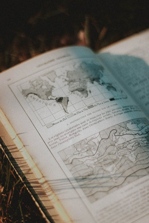 Old book with map illustration in sunlight