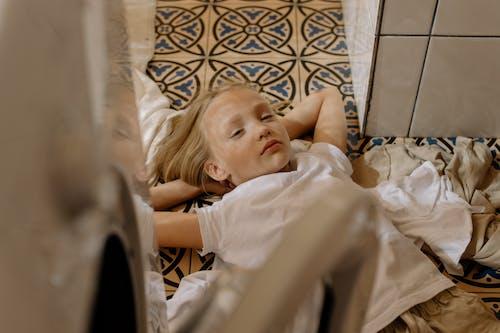 Girl Feeling Sleepy Inside the Laundry Room
