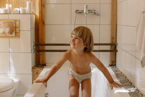 Little Boy Standing on the Bathtub
