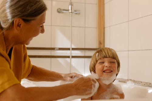 Grandmother Helping Her Grandson Take a Bath