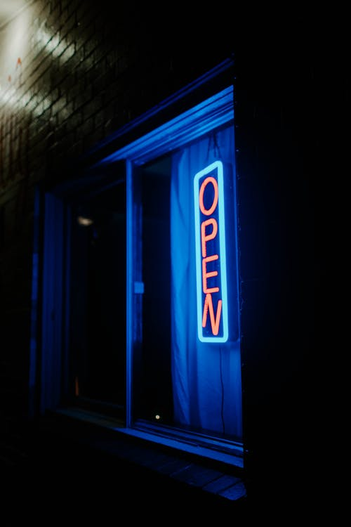 Blue and White Open Neon Signage