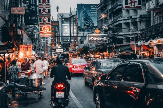 Crowded Street With Cars Passing By