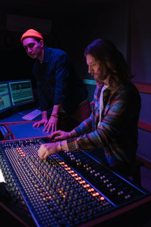 Man Using a Mixing Console