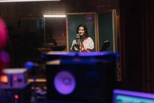 Woman Recording a Song