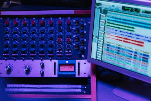 Close-Up Shot of a Mixing Console