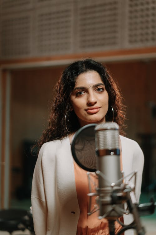 A Beautiful Singer Recording a Music