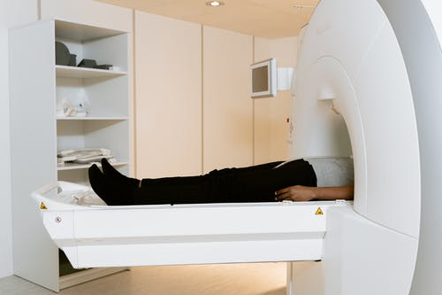Photo Of Person Laying Down On A CAT Scanner