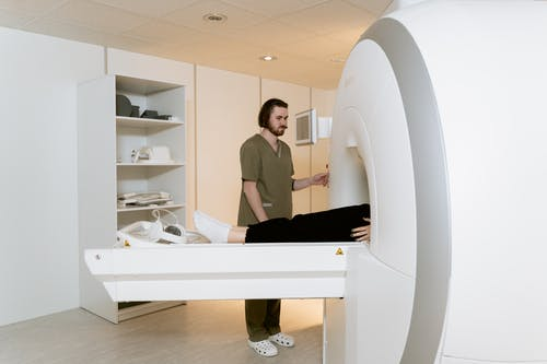 Photo Of Radiologist Operating The CT Scanner