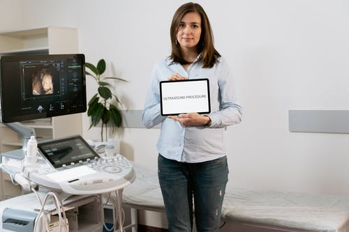 Photo Of Woman Holding Tablet