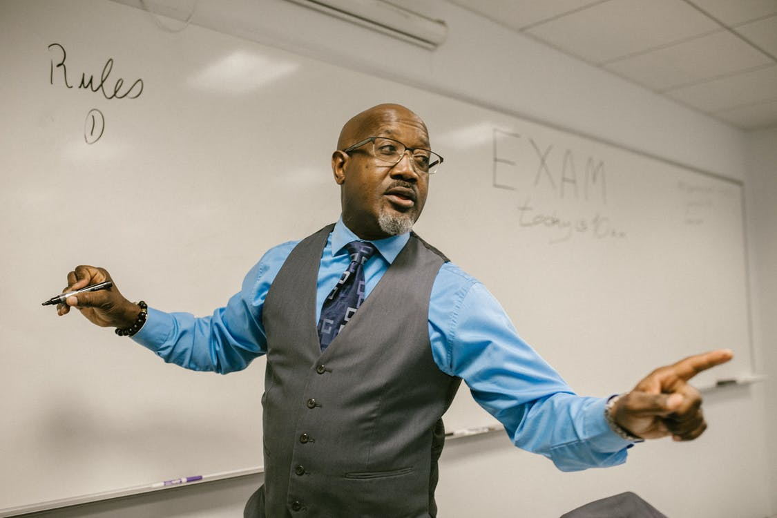 Teacher Giving Out Instructions Not to Cheat