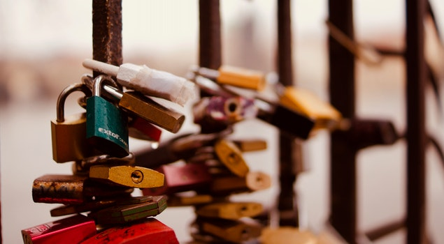 Selective Focus Photography of Padlocks on Fence