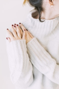 Woman Wearing Turtleneck Sweater in White Surface