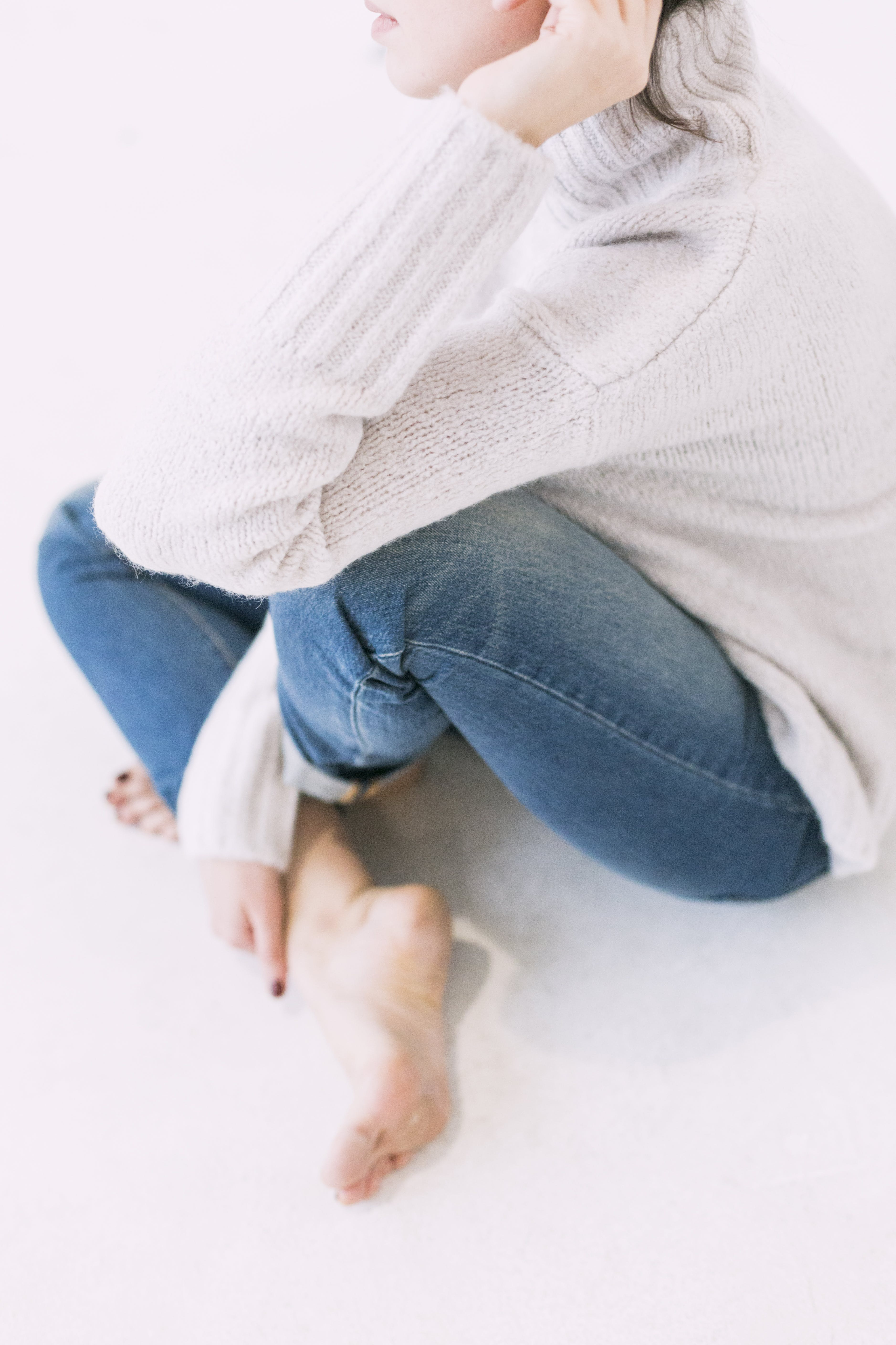 Woman in Gray Sweater and Blue Denim Jeans