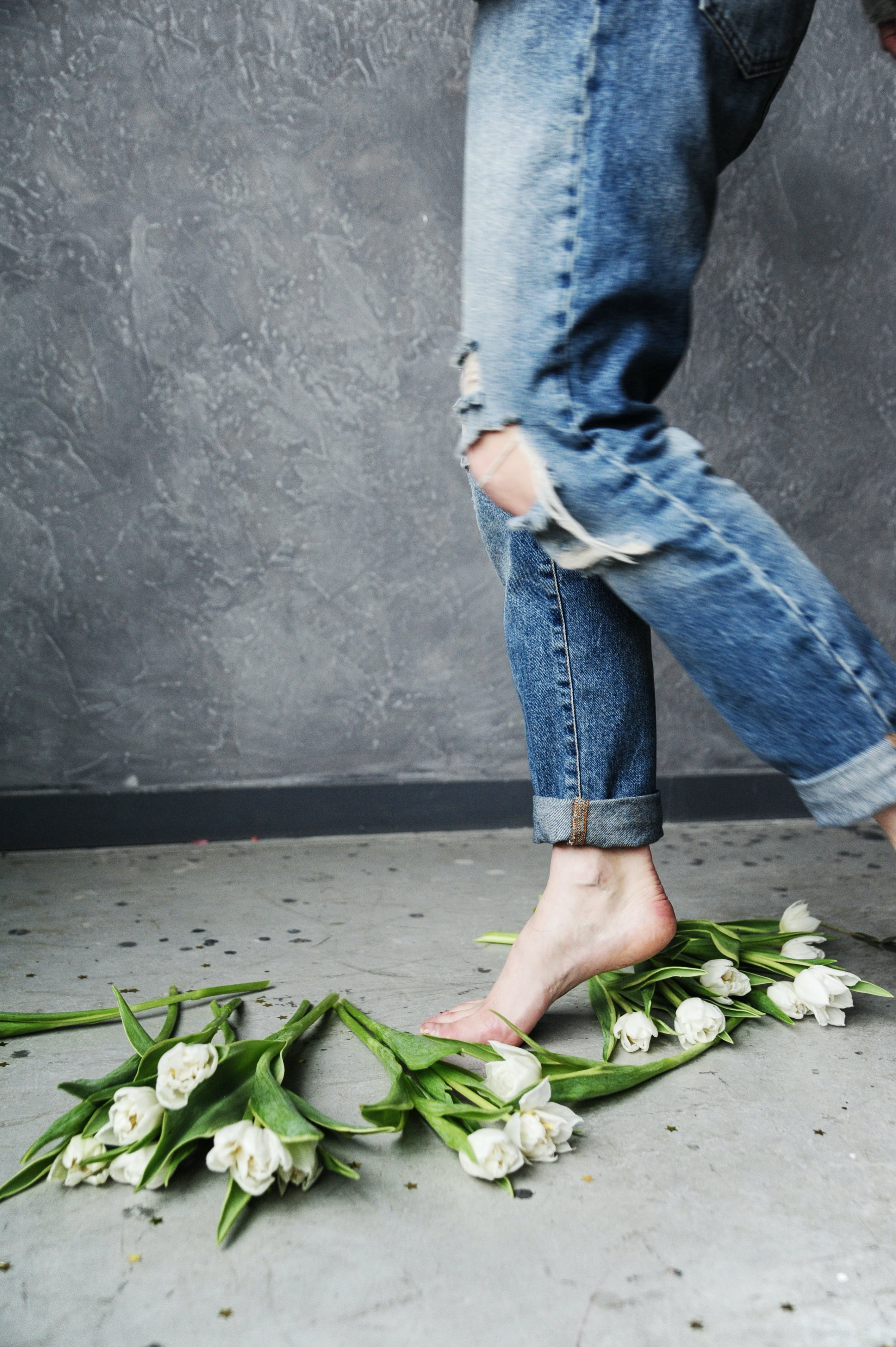 Person in Blue Ripped Jeans