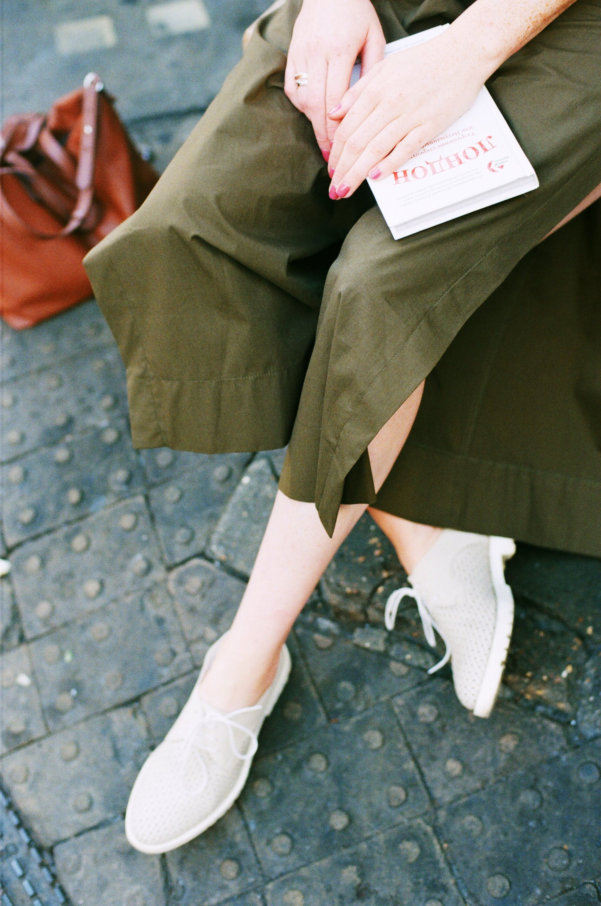Person Wearing Green Skirt and Pair of White Low Top Sneakers