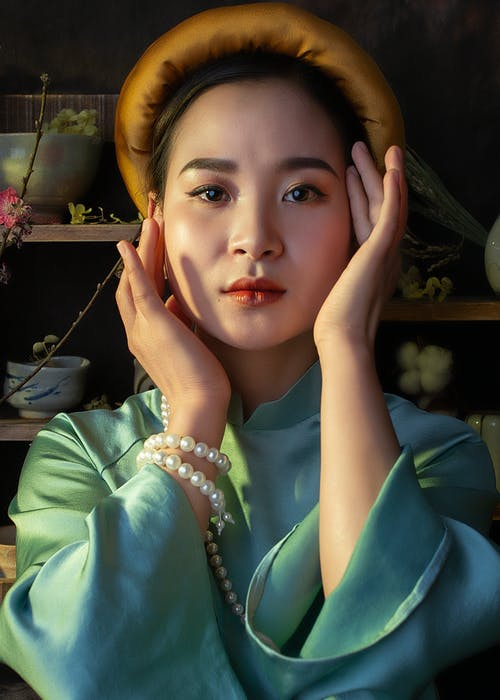 Stylish Asian woman in elegant clothes looking at camera