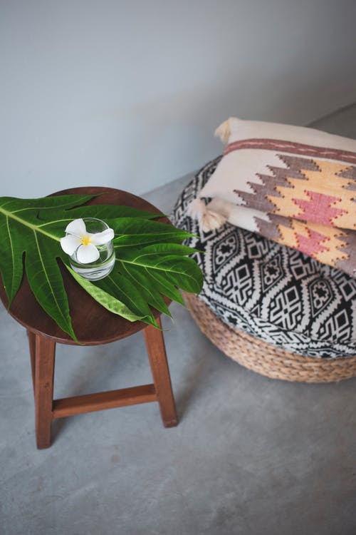 Chair near blanket and cushions in wicker basket