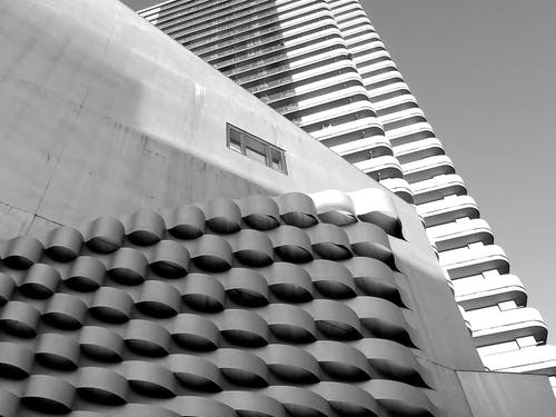 Black and white of geometric buildings on city street