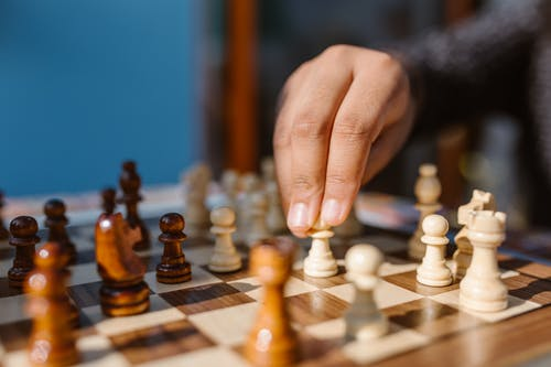 A Person Playing Chess Game