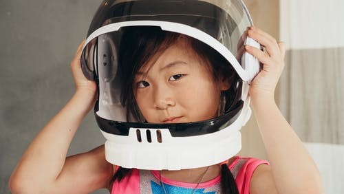 Girl in Pink and Blue Tank Top Wearing White Helmet