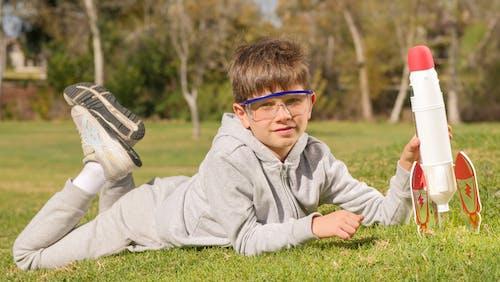 Boy in Gray Hoodie Wearing Blue Framed Eyeglasses