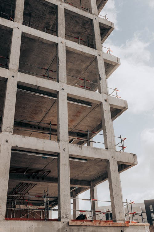 Low angle detail of semi built modern multistage building at construction site in city