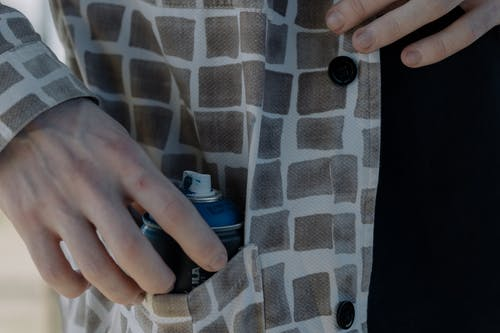 Person Holding Spray Paint Inside of the pocket