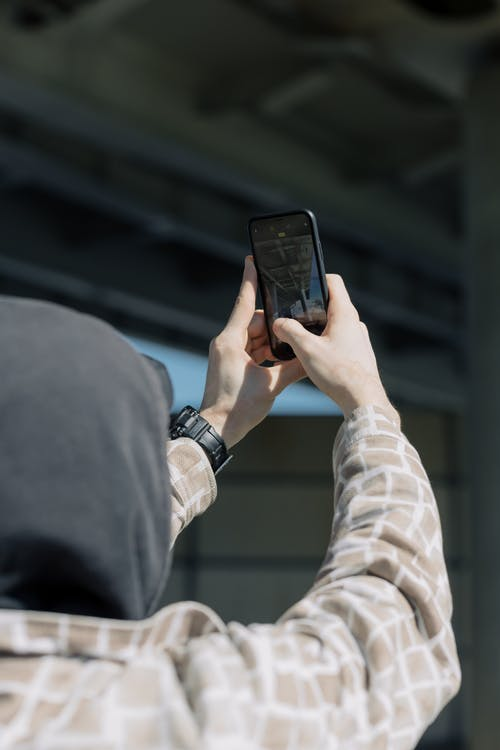 Person Taking Photo on His Mobile Phone
