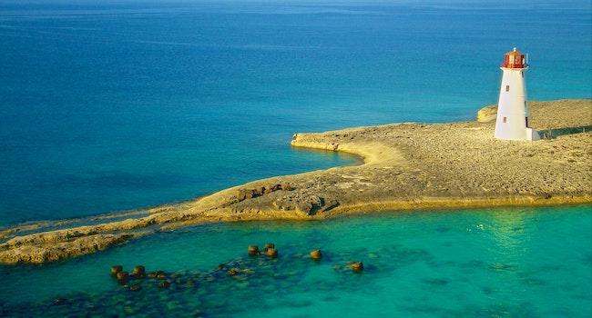 Bird's Eye Photography of White Lighthouse on Island