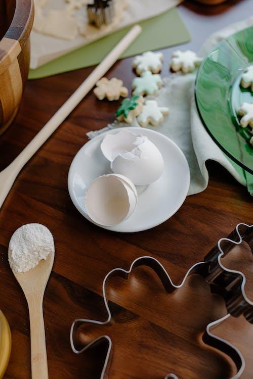 White Ceramic Bowl on Brown Wooden Spoon