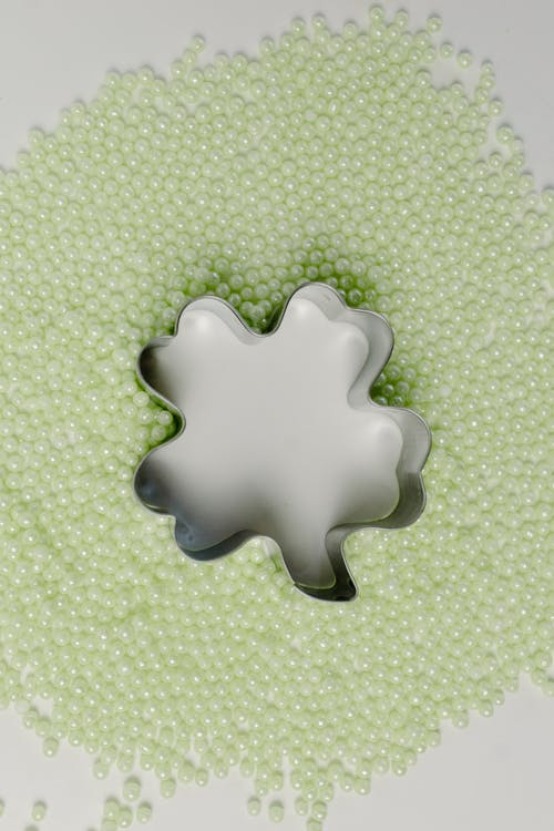 White and Green Plastic Toy