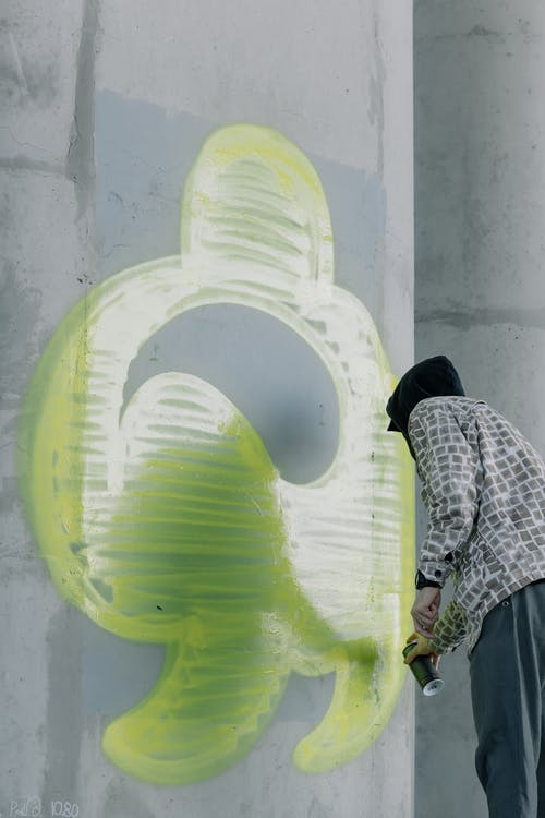 Person Holding a Spray Paint