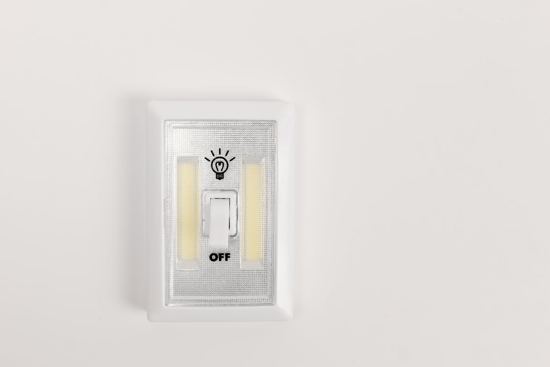 White and Gold Wall Mounted Device