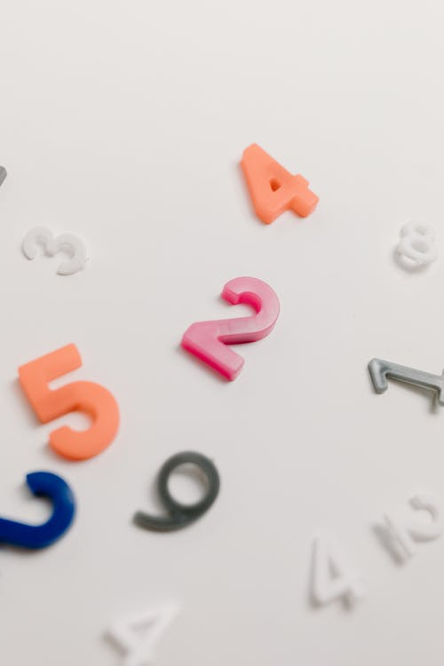 Plastic Numbers on White Background