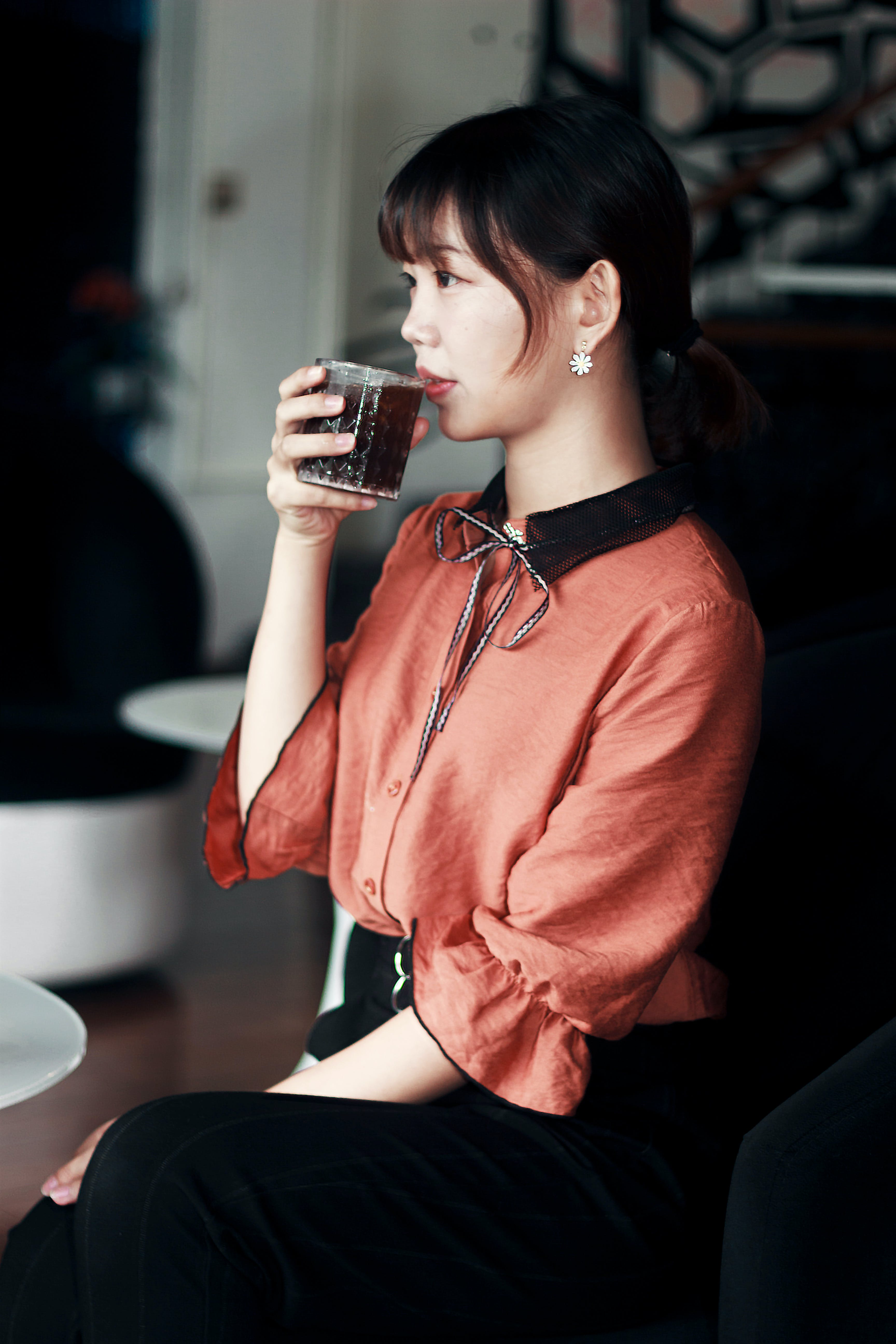Woman in Pink and Black Dress Drinking Cola