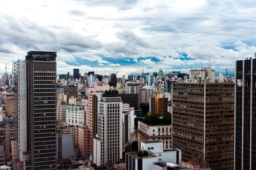 High Rise Buildings Under White Clouds and Blue Sky