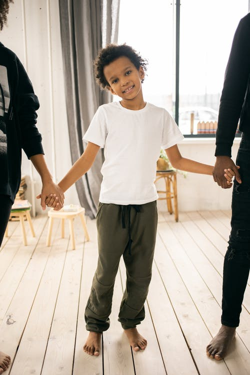 Black boy with anonymous family