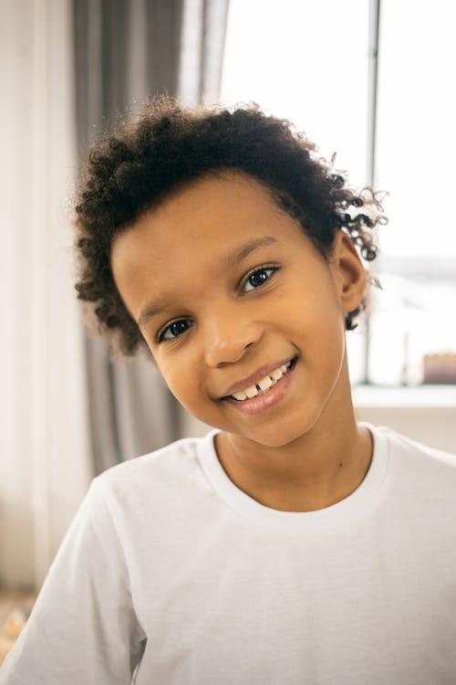 Smiling black boy in room