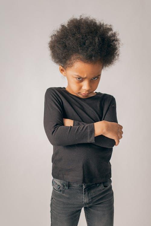 Offended black girl in studio