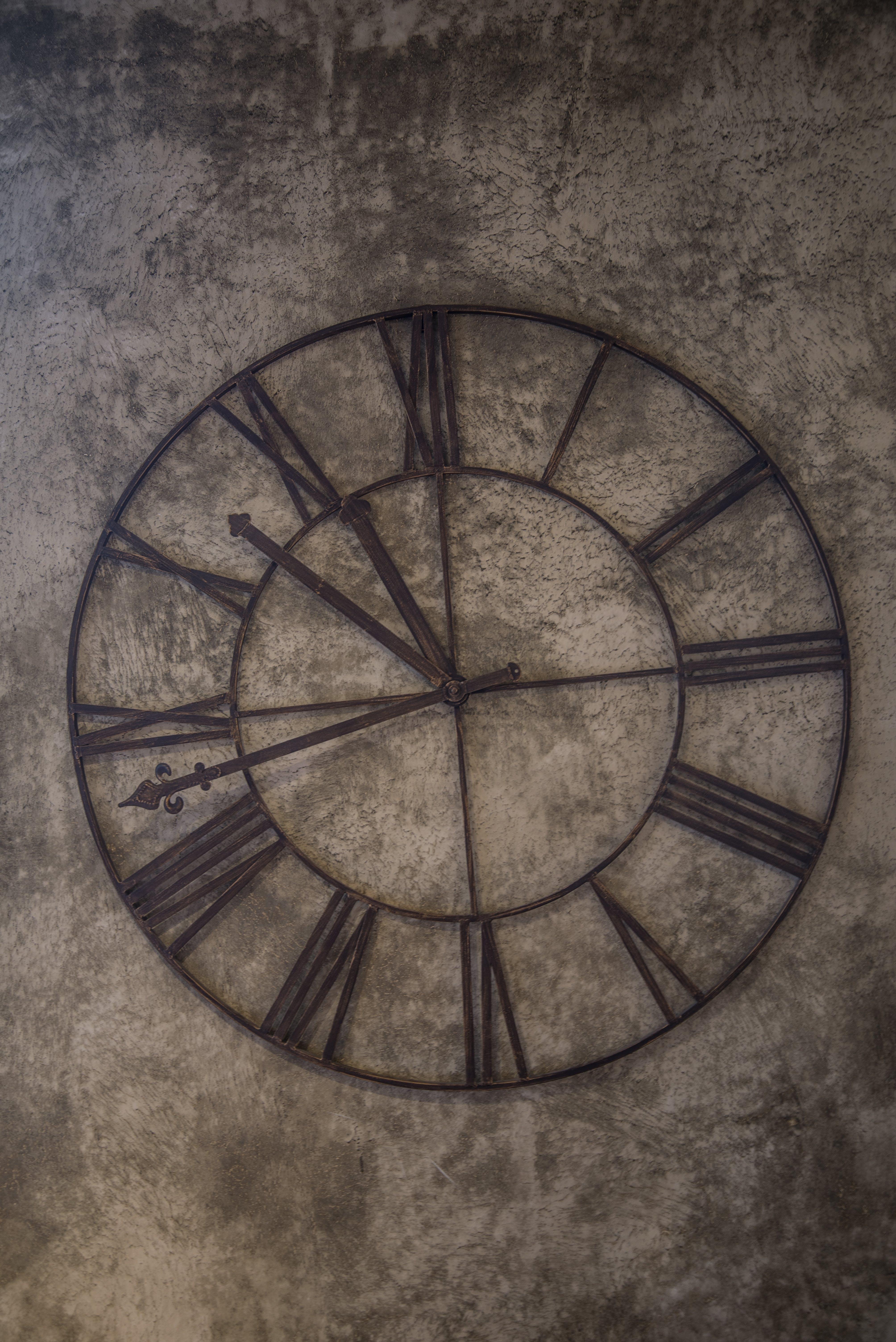 Brown Analog Wall Clock at 11:48