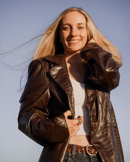 Woman in Black Leather Jacket Smiling